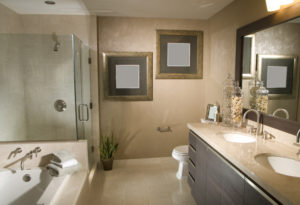 Bathroom wiht Warm earth tones and dark wood cupboards